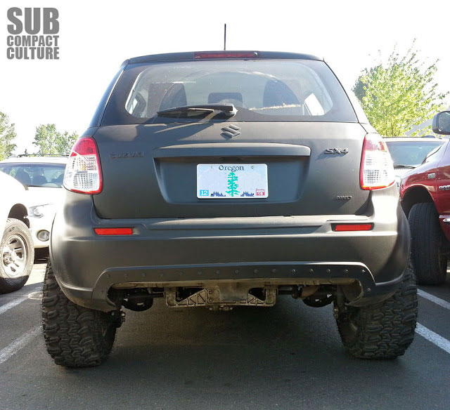 Back end of the most evil looking Suzuki SX4 ever