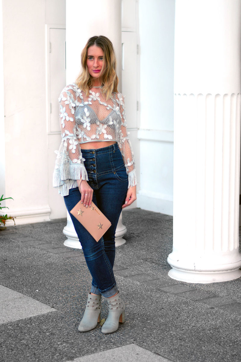 australian street style alice mccall california sun top with high waist jeans michael kors blush clutch with silver stars grey star print ankle boots