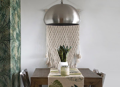 Macrame wall hanging over dining table