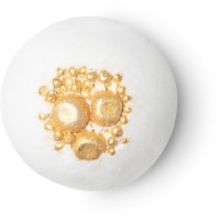 A white spherical bomb with gold flakes of sea salt in the centre of it on a white background