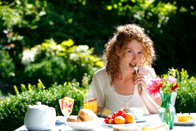 A woman enjoying a healthy meal outdoors