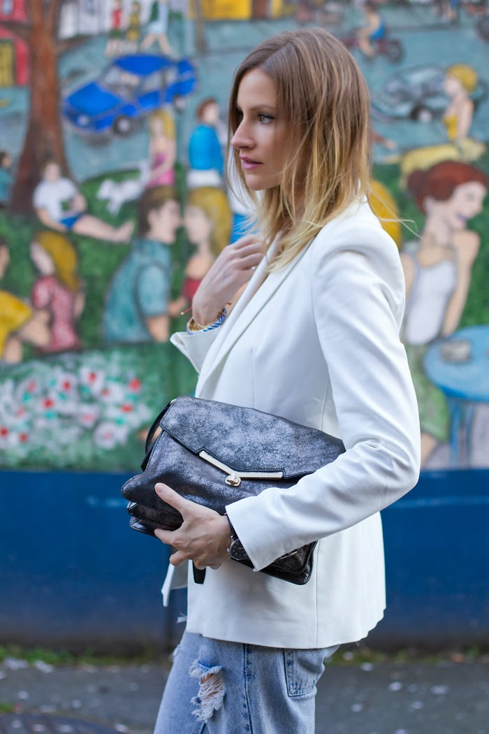 Vancouver Fashion Blogger, Alison Hutchinson, is wearing a white Zara blazer, a white ATM tank top, One Teaspoon Awesome Spaceboy Baggies, red Browns heels, a silver Botkier Valentina bag, and a necklace from La Dama
