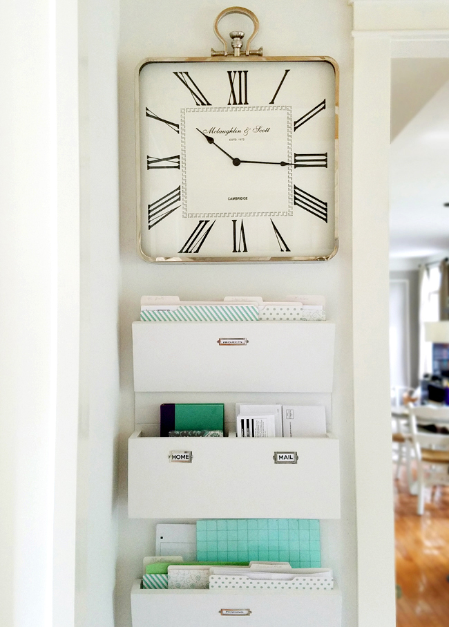 big clock on wall and mail sorters