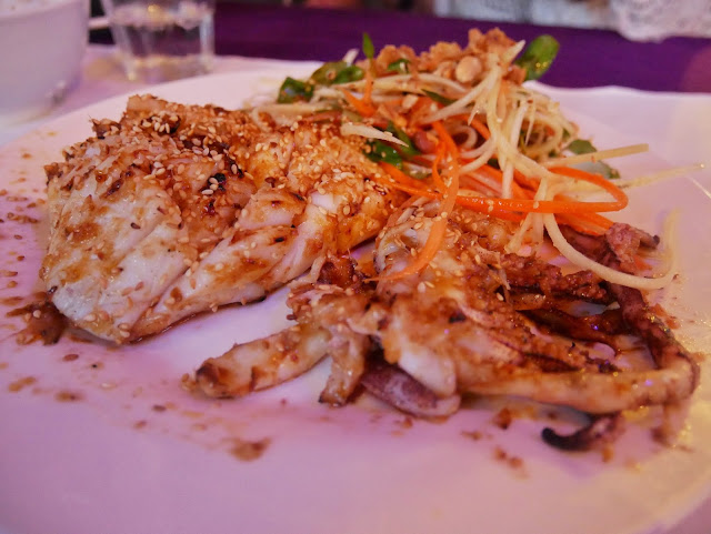 Grilled squid served with salad