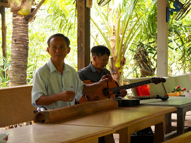 Local musicians playing traditional instruments in the Mekong Delta, Vietnam
