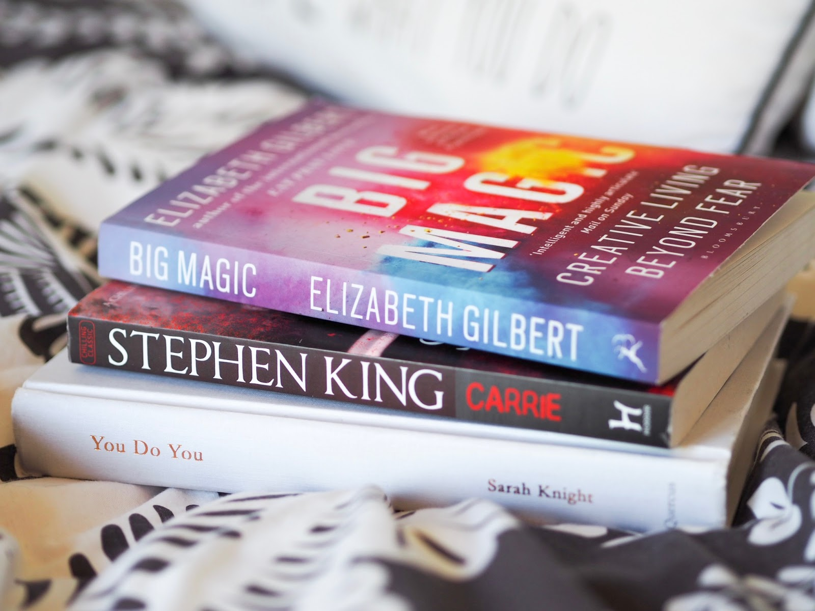 Three books on bed