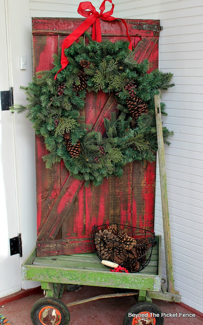 make a barn door from pallet wood to hold a wreath or other decor