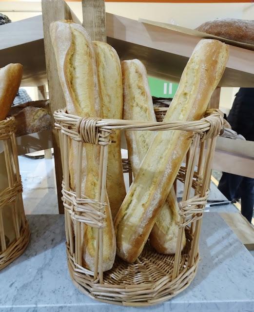 Freshly baked baguettes in a wicker basket