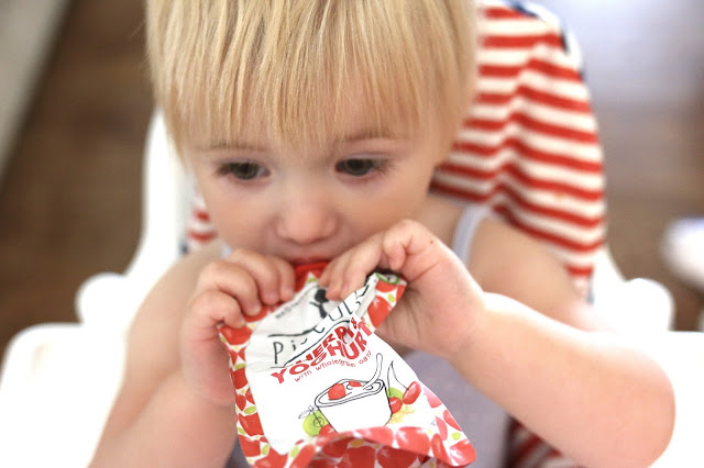 teething baby refusing to eat eating a piccolo fruit and yoghurt pouch