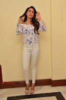 Actress Pragya Jaiswal Latest Pos in White Denim Jeans at Nakshatram Movie Teaser Launch  0048.JPG