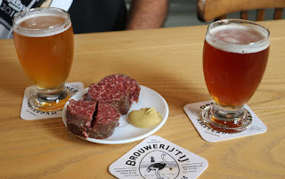 Two beers, and some lovely raw smoked sausage