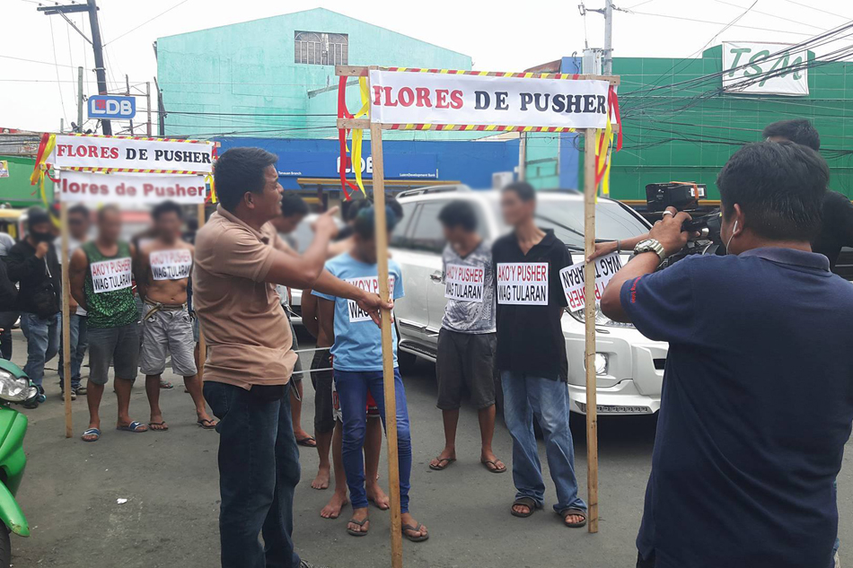 "Suspected drug pushers forced to take ""Flores de Pusher"" walk of shame in Tanuan"