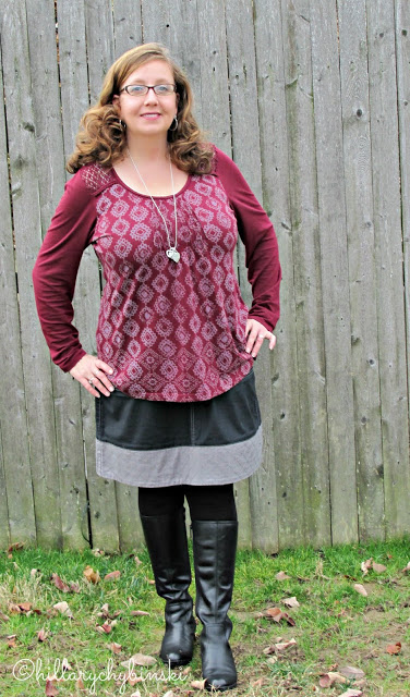 A Wine Top Paired iwth a Casual Black Skirt