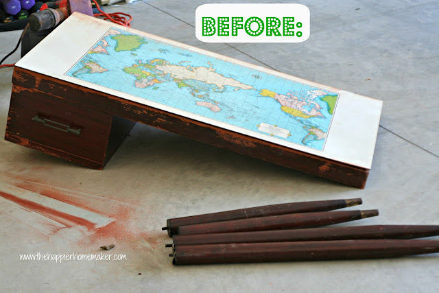 A before picture of a map top desk that needs restaining