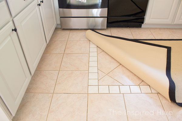 How to diguise ugly flooring. Hide it with a rug! And don't forget the rug pad!