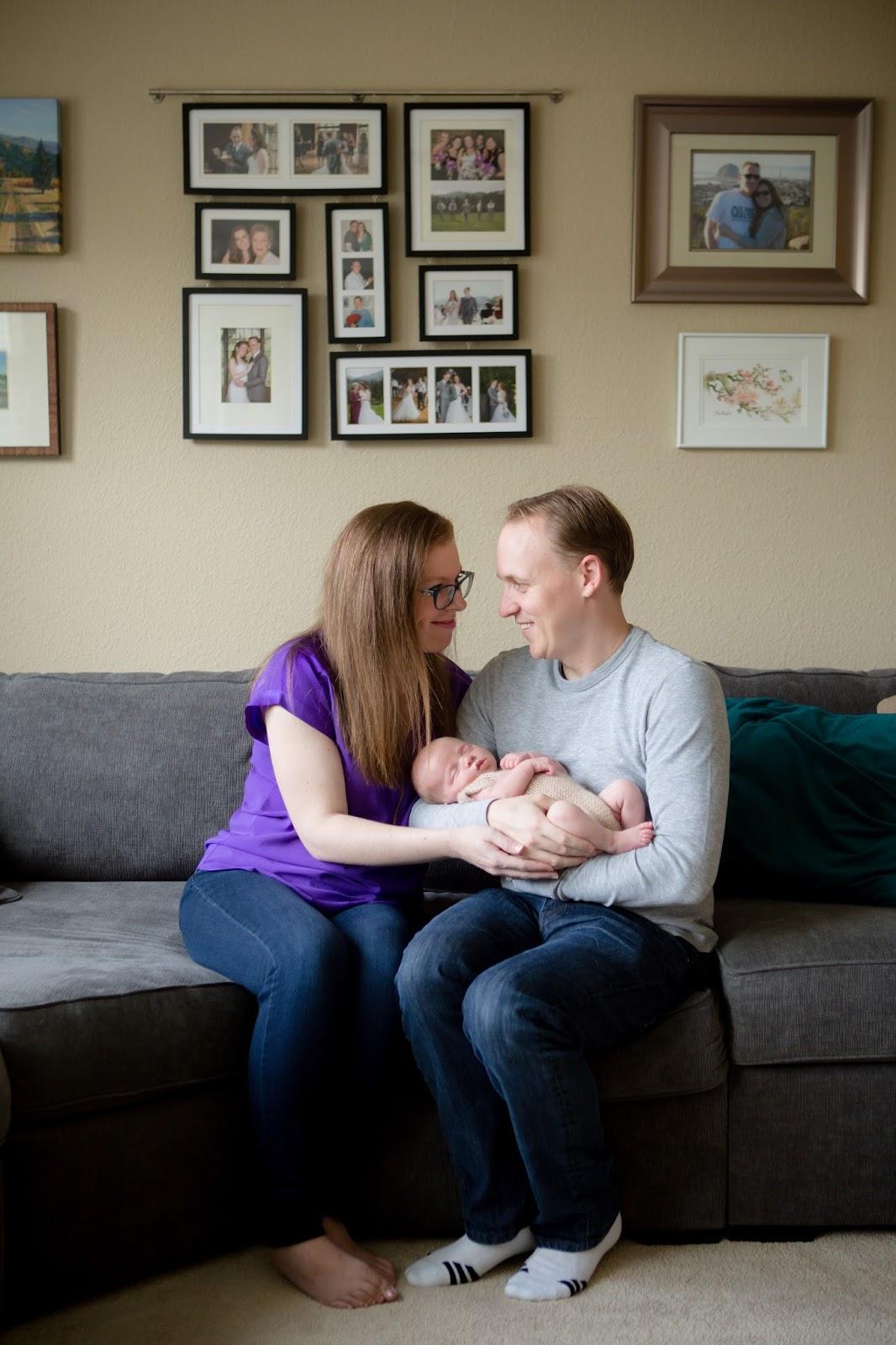 new family beneath wedding photos