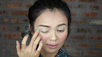 Sparkling Green New Year's Eve make up -Next, to the eyes area. Apply this shimmery color to the entire eyelid and then blend it towards the brow bone.