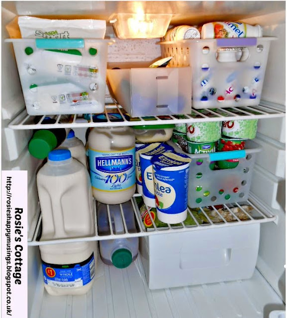 Refrigerator organization using bins - Fridge interior organized.