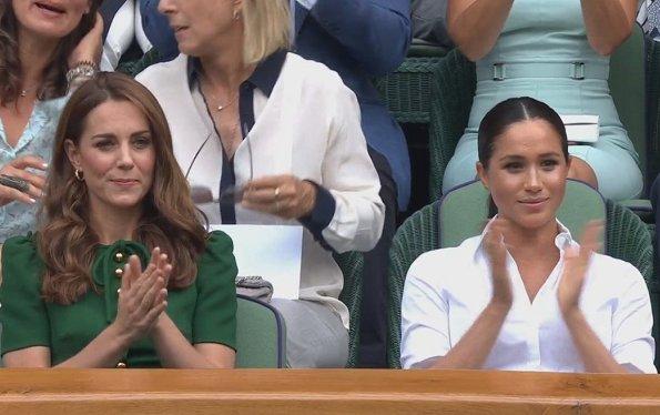 Kate Middleton wore a green midi dress by Dolce & Gabbana. Meghan Markle wore a print midi skirt by Hugo Boss