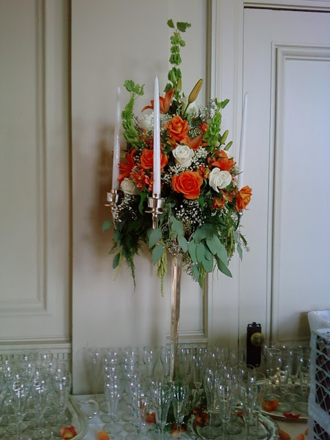 Candelabra adorned with flowers for a wedding at the Cairnwood Estate by Stein Your Florist Co.