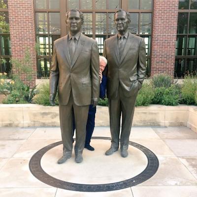 Lol. Bill Clinton Seen Hiding Behind Some Bushes