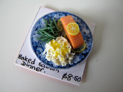 Baked salmon dinner in one-twelfth scale.