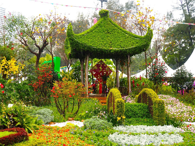 Pagoda and bridge covered in flowers in a garden at Hong Kong Flower Festival 2017