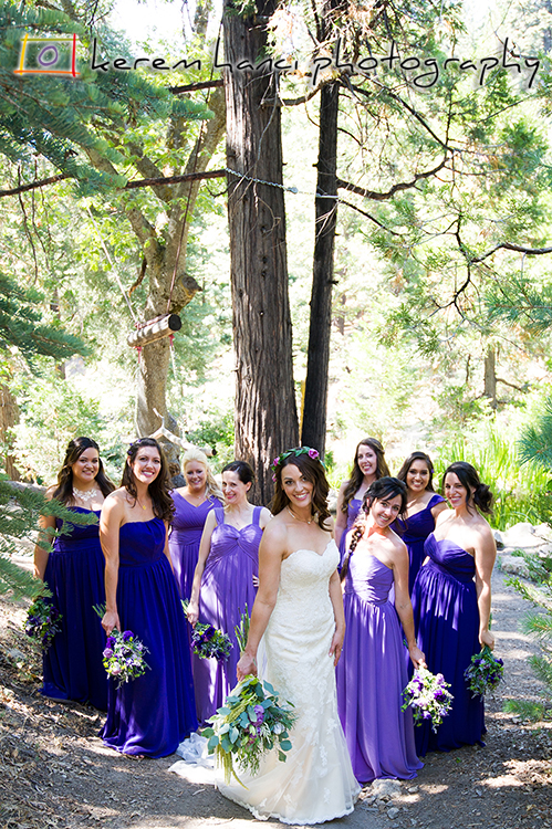 The bride under the lovely pine trees of the Pine Rose Cabins