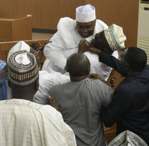 Photos: Excited Dino Melaye lifts up senate president, Bukola Saraki, moments after CCT cleared him of all false asset declaration charges