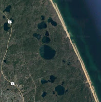 Several of the Cape Cod National Seashore kettle ponds are seen in this satellite image. (Credit: Google) Click to Enlarge.