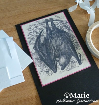 Black and white bat image cut out and mounted onto a pennant flag section