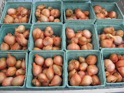 shallots in aqua pint containers