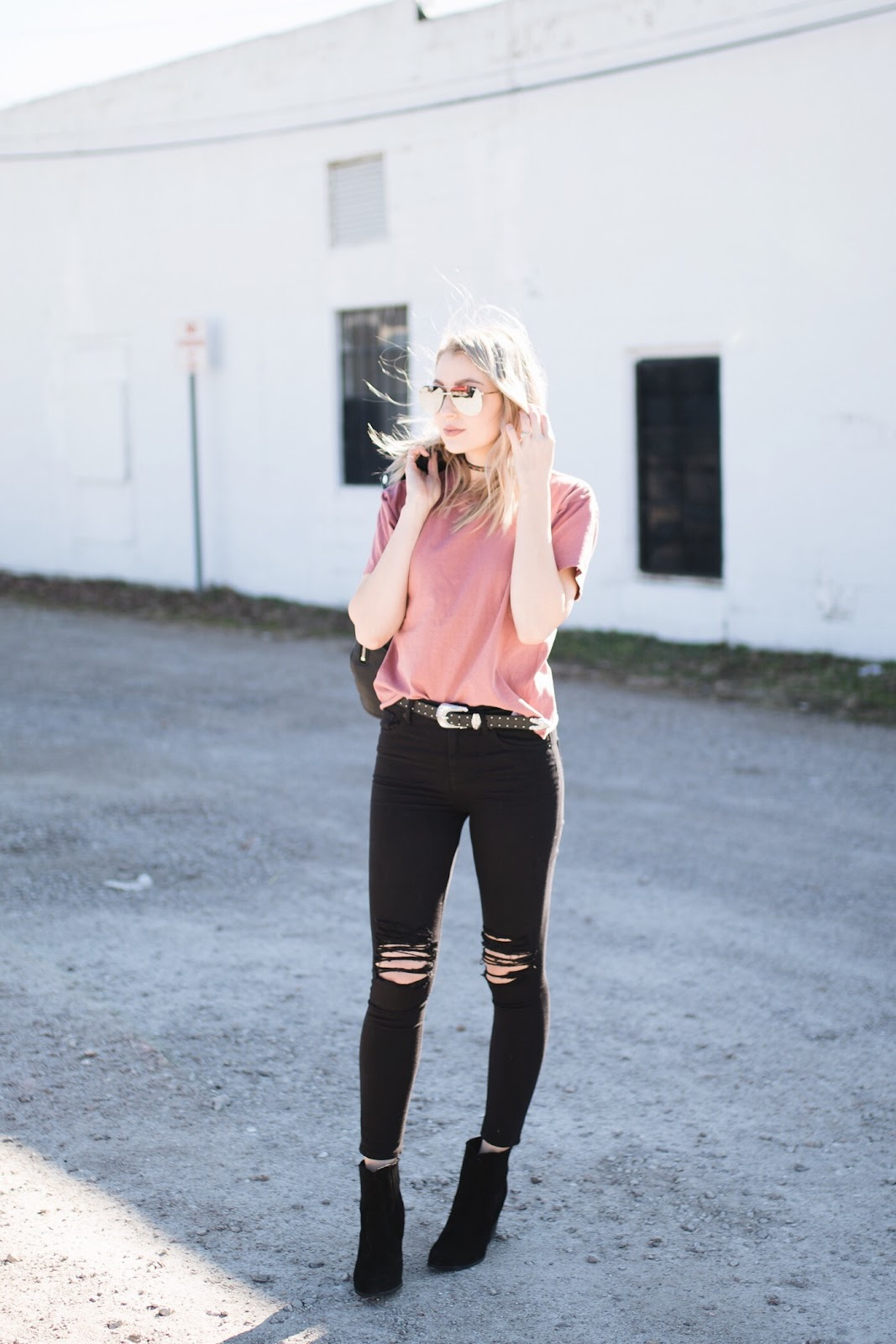 Black distressed skinny jeans, tee, ankle boots, belt