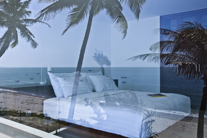Bed and ocean reflection in glass