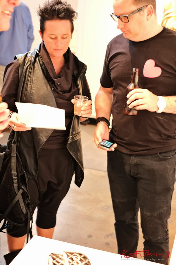 Art Patrons dressed in balck at Will Coles Death Wish 2013 - Brenda May Gallery Sydney.