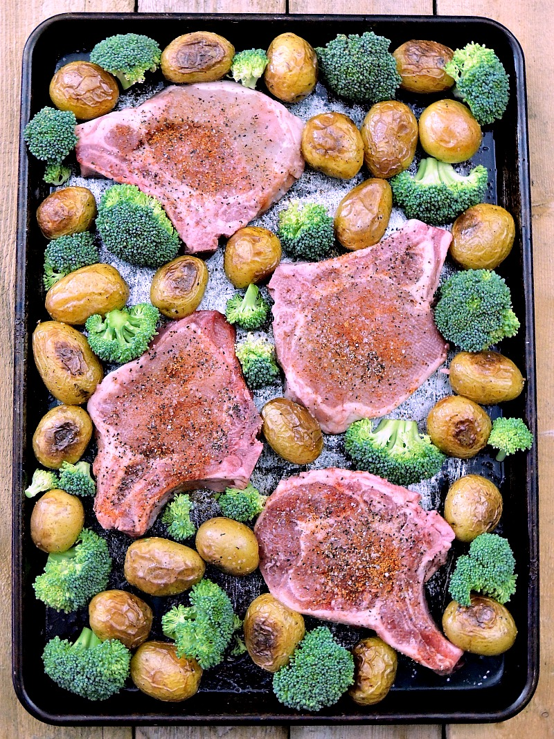 Sheet Pan Cajun Pork Chops with Potatoes and Broccoli - This sheet pan meal is super easy, full of flavor, AND there is only one pan to clean from www.bobbiskozykitchen.com