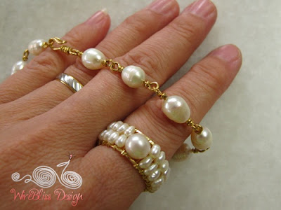 A pearl bracelet and adjustable wire wrap ring, with tiny pearls
