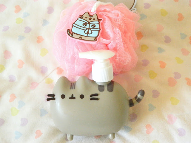 A photo showing two items from the Pusheen Box Autumn 2018, a loofah and a soap dispenser