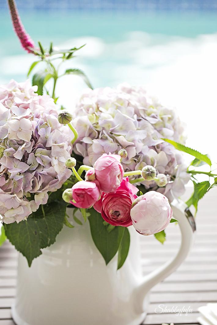 ranunculus hydrangeas peonies in a floral arrangement shabby chic