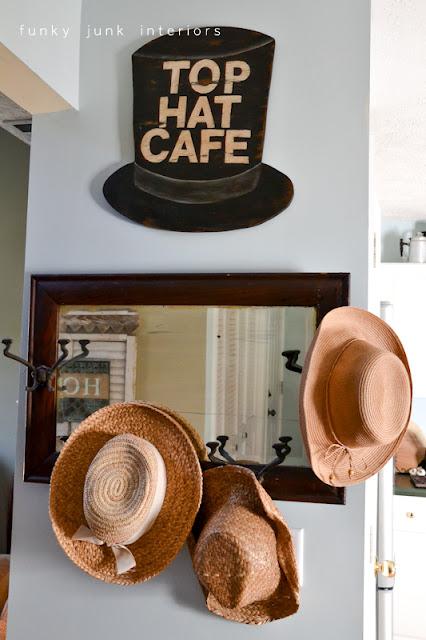 A junk tour of Bella Rustica Linda's house via Funky Junk Interiors - hat wall