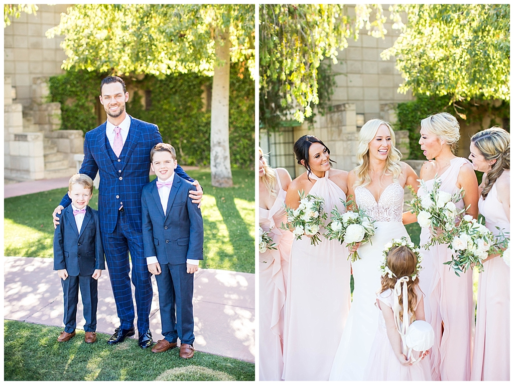 groom with ring bearers in blue suits and bride with bridesmaids in blush dresses