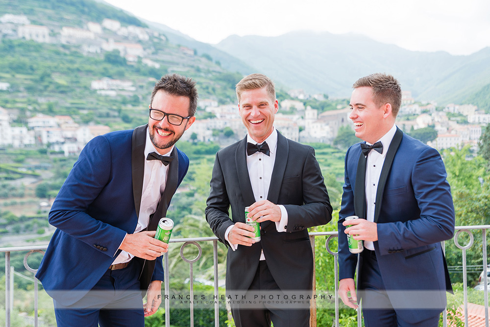Groomsmen having a beer for portraits