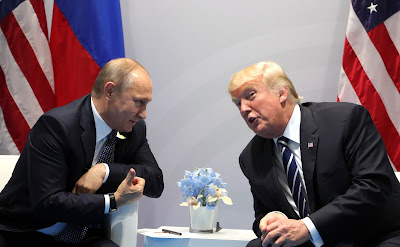 Vladimir Putin with US President Donald Trump.