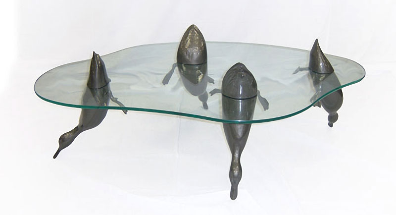 Lovely Coffee tables featuring sculpted hippos ducks dolphins seals frogs and otters breaking the glass surface by British artist Derek Pearce