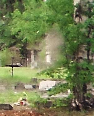 The misty figure in this photo taken by paranormal researcher Jessie Desmond, is a supposed ghost in Birch Hill Cemetery located in Fairbanks, Alaska