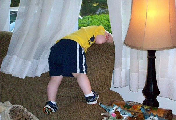 15+ Hilarious Pics That Prove Kids Can Sleep Anywhere - Napping Before The Escape Plan Through The Window