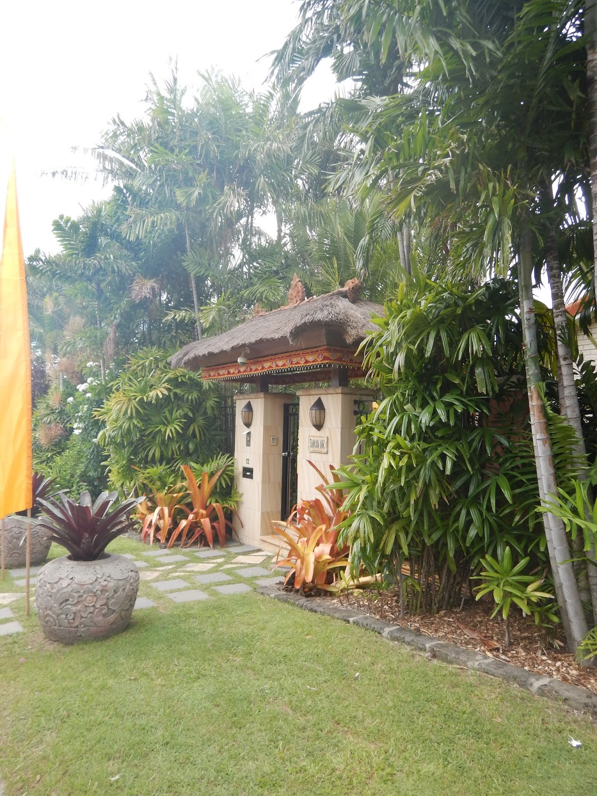 the main street entrance to taman air the sunnybank garden of rene and carolyn hundscheidt flanked by bronze coloured aechmea blanchetiana and - Tropical Garden 2016