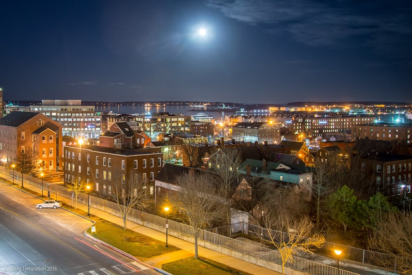 Portland, Maine USA February 2016 photo by Corey Templeton. The moon rising into the clouds. Viewed from above Spring Street.