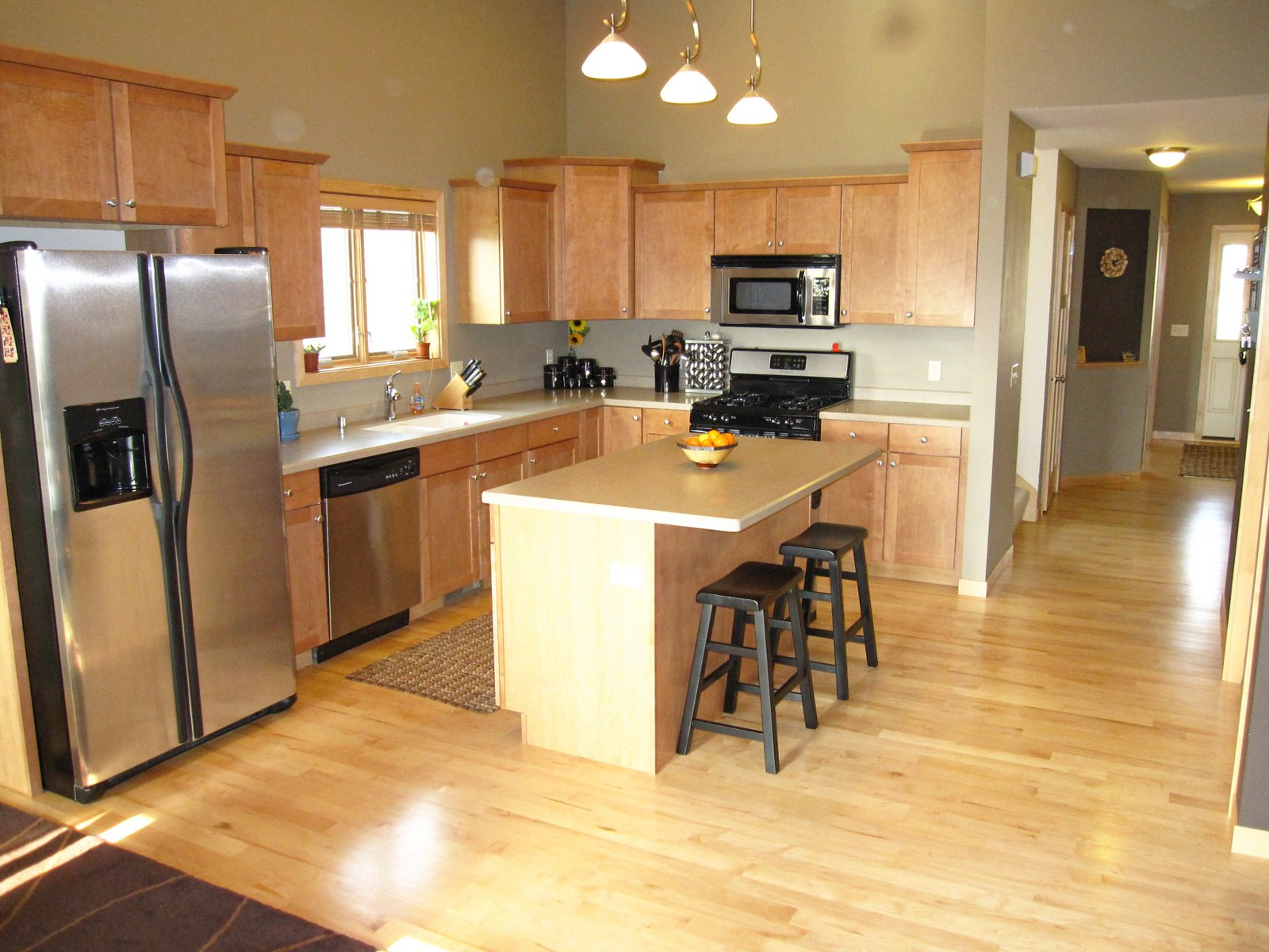 On the Market: 5645 Kinsale: Great Room on Maple Cabinets Kitchen  id=40898