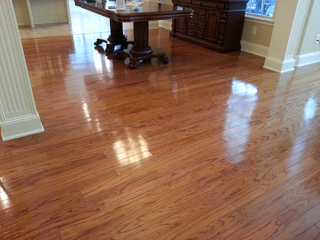 A dining room wood floor polished and protected job